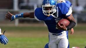 Riverhead RB Ryun Moore goes up the middle