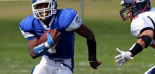 Riverhead RB Ryun Moore hits the hole for
