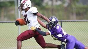Bay Shore's Bradley Pierre (21) makes it into