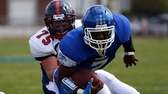 Riverhead RB Ryun Moore dives for extra yardage