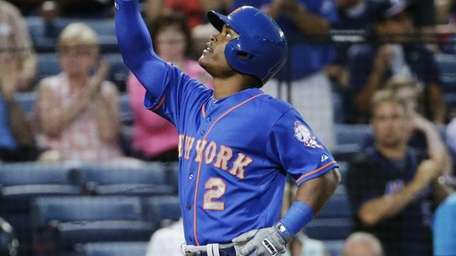 Mets' Dilson Herrera points to the sky as