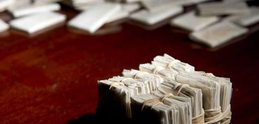 A sleeve of heroin packets is shown at