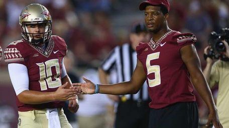 Jameis Winston of the Florida State Seminoles shakes