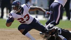 Houston Texans running back Arian Foster, left, carries