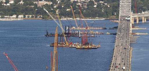Construction equipment is positioned near the Tappan Zee