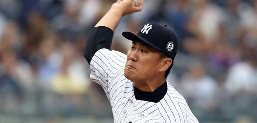 Yankees pitcher Masahiro Tanaka delivers a pitch during