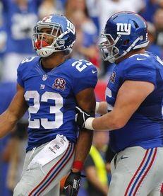 Rashad Jennings #23 of the Giants celebrates a
