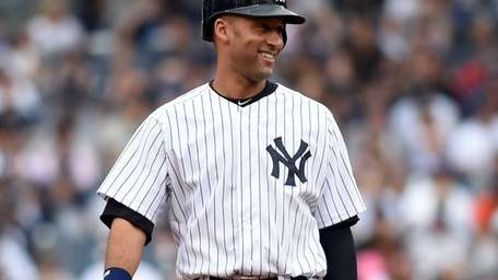 The Yankees' Derek Jeter stands on second base