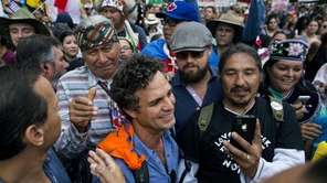 Actors and activists Mark Ruffalo, center left, and