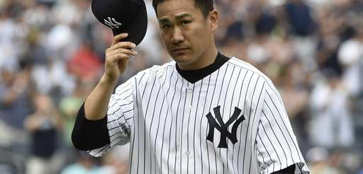 Yankees starting pitcher Masahiro Tanaka tips his hat