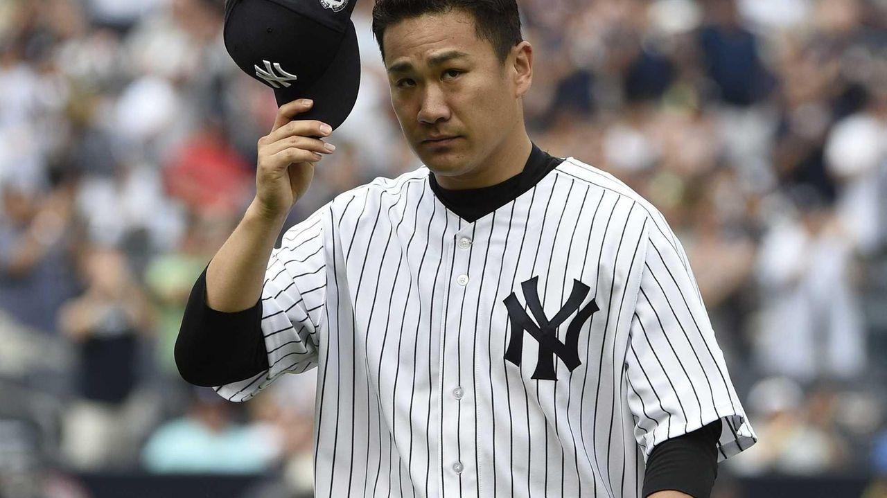 Yankees starting pitcher Masahiro Tanaka tips his hat