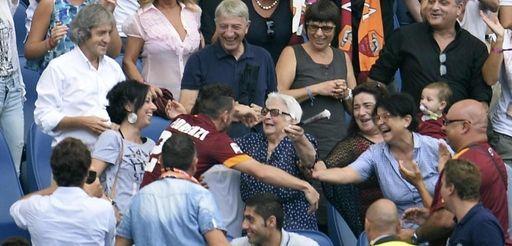 Roma forward Alessandro Florenzi gives his grandmother a