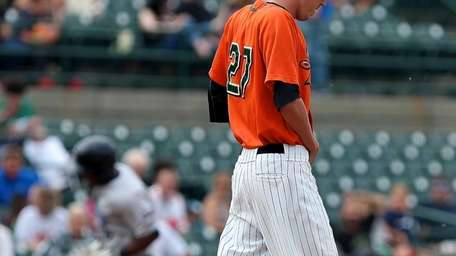 Long Island Ducks relief pitcher Tommy Organ hangs