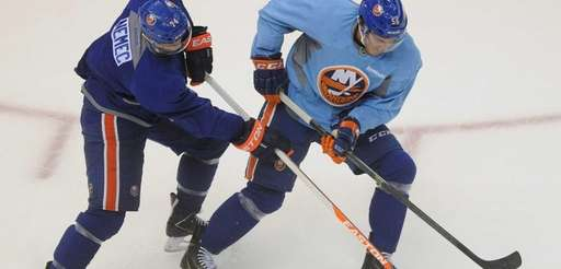 The Islanders' John Persson, right, and Mark Nemec