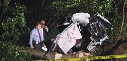 Investigators at the scene of fatal single-car crash