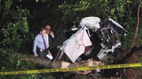 Investigators at the scene of fatal single-car crash