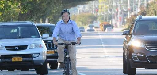 Suffolk County Executive Steve Bellone rides his bicycle