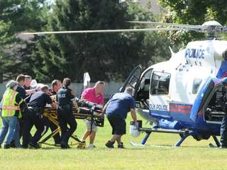 A Suffolk County police officer is transported into