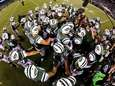 The Jets huddle before a game against the