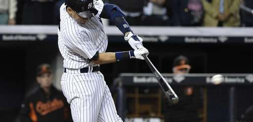 Yankees shortstop Derek Jeter hits a two-run double