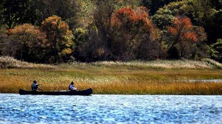 A couple canoes along the Nissequogue River near