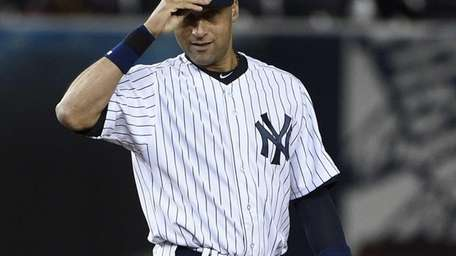 Yankees shortstop Derek Jeter reacts after the last
