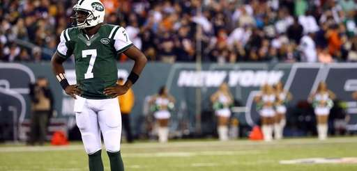 Quarterback Geno Smith of the Jets looks on