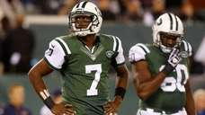 Geno Smith #7 and D'Brickashaw Ferguson #60 of