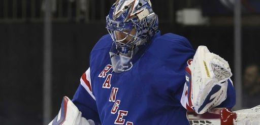 Rangers goalie Henrik Lundqvist (30) reacts after giving