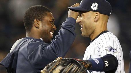 Yankees designated hitter Jose Pirela, left, celebrates with