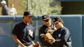Yankees first-round draft pick Derek Jeter, left, compares