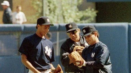 Yankees first-round draft pick Derek Jeter, left, compares