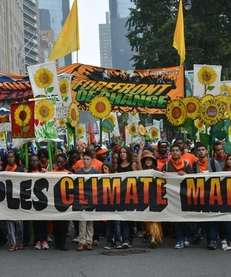 Participants in the People's Climate March walk south