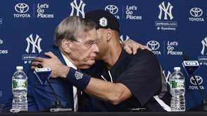 The Yankees' Derek Jeter, right, embraces MLB commissioner