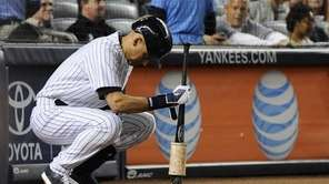Yankees shortstop Derek Jeter waits on deck to