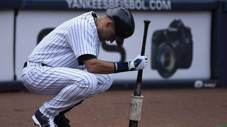 Derek Jeter waits on deck to bat in