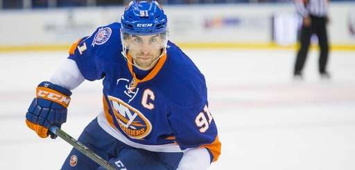 Islanders center John Tavares (91) skates in the