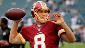 Washington Redskins quarterback Kirk Cousins looks to pass
