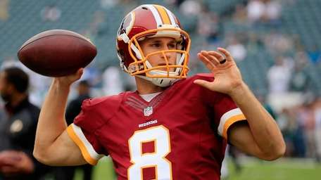 Washington Redskins quarterback Kirk Cousins looks to pass