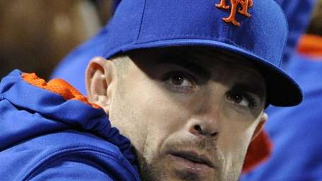 Mets third baseman David Wright looks on during