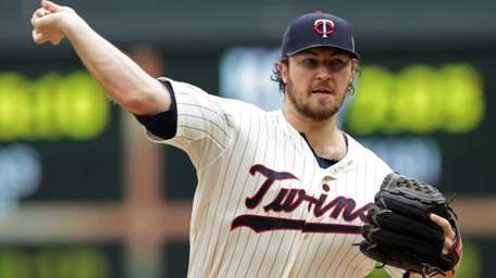 Minnesota Twins pitcher Phil Hughes throws against the