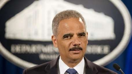 Attorney General Eric Holder at a news conference