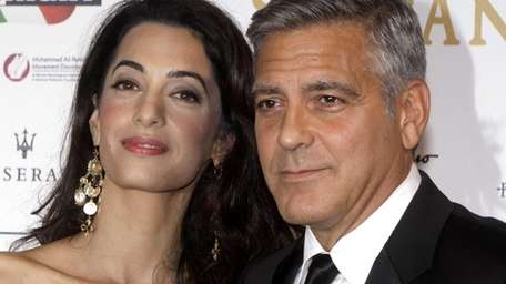 George Clooney and his fiancée, Amal Alamuddin, arrive
