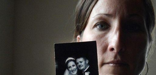 Danielle McDonnell, of Lindenhurst, holds her 2001 wedding