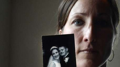 Danielle McDonnell, of Lindenhurst, holds her 2001 wedding