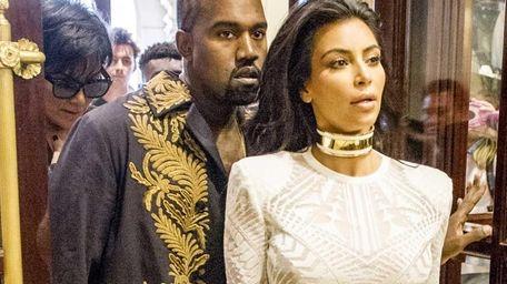 Kim Kardashian and Kanye West arrive at the