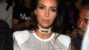 Kim Kardashian attends the Balmain Spring/Summer 2015 ready-to-wear