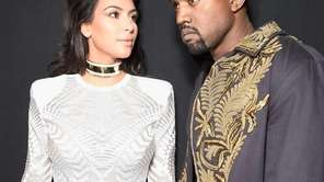 Kim Kardashian and Kanye West attend the Balmain