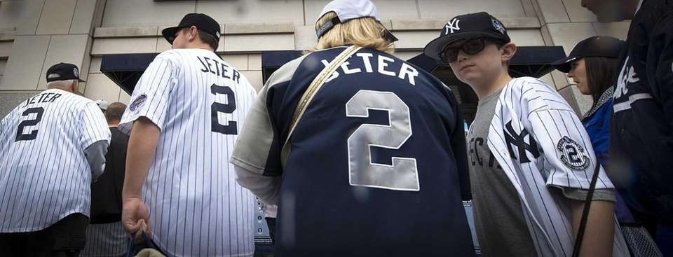 Derek Jeter fans enter Yankee Stadium with their