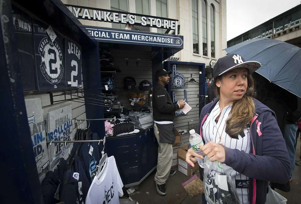 Nicole Eaton of Rensselaer tries on Yankee hats